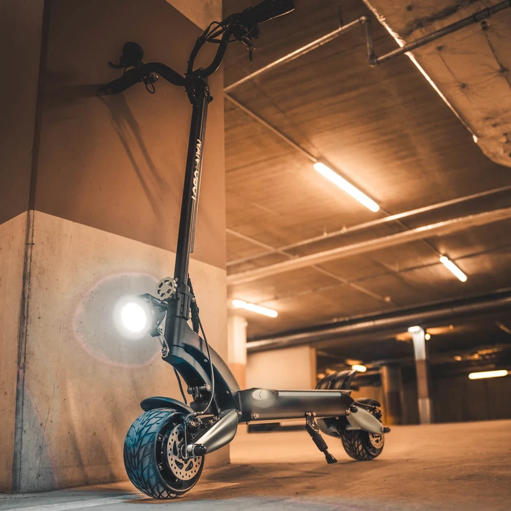 Nanrobot Lightning e-scooter in a parking garage with all its lights on