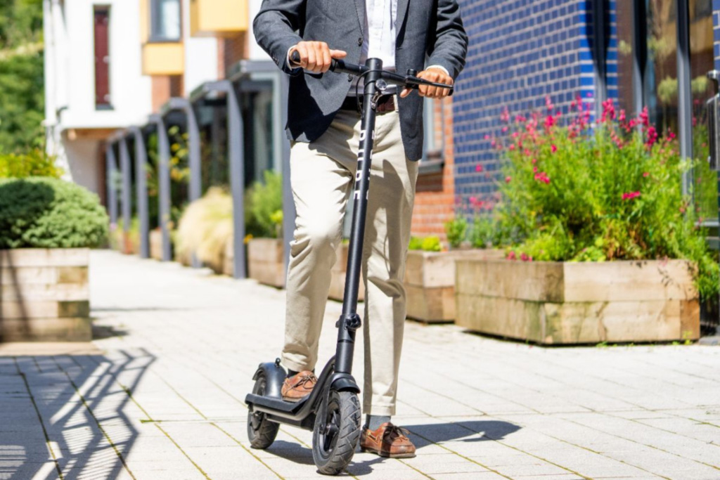A man riding his Pure Air e-esooter to work