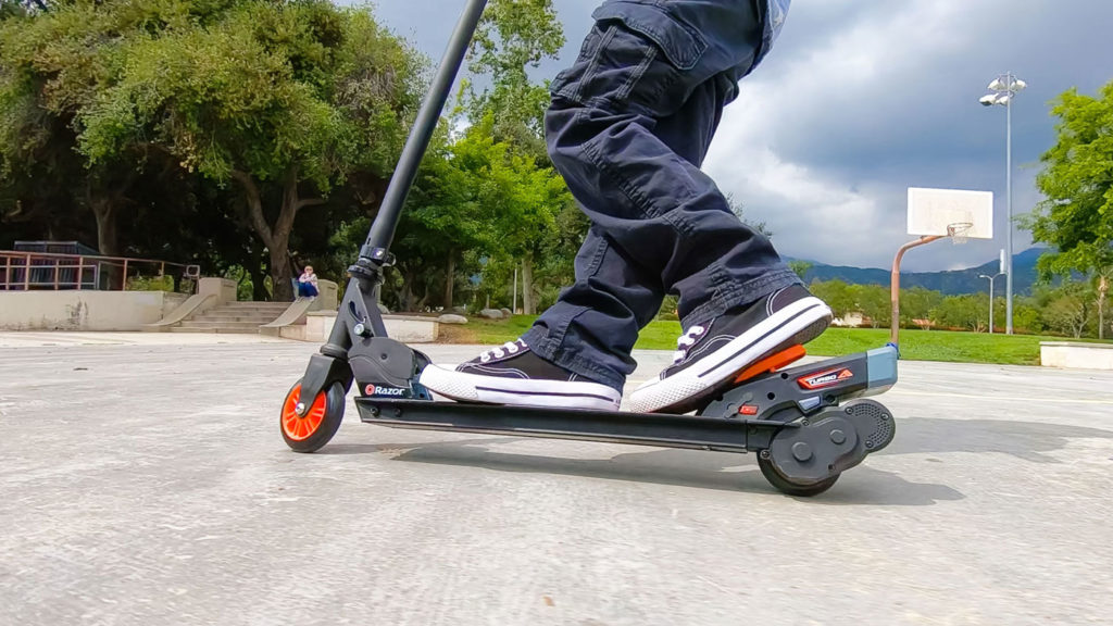 A picture of a child riding on the Razor Turbo A electric scooter